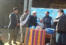 Welfare organization distributes warm clothes among needy schoolchildren